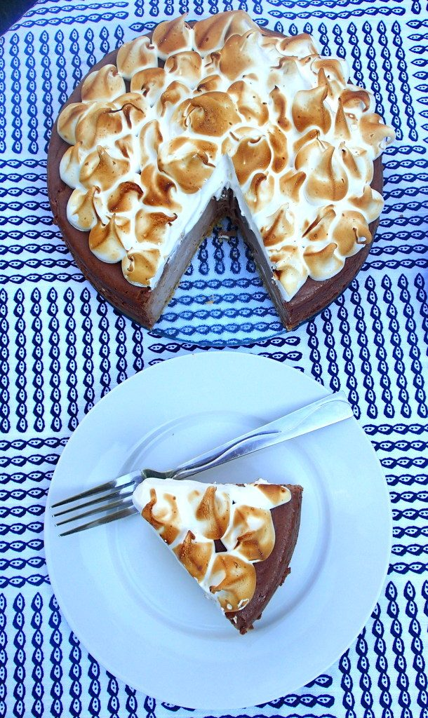 S'mores Cheesecake -  A classic graham cracker crust, caramel chocolate cheesecake, and a marshmallow meringue topping. From dirtydishclub.com